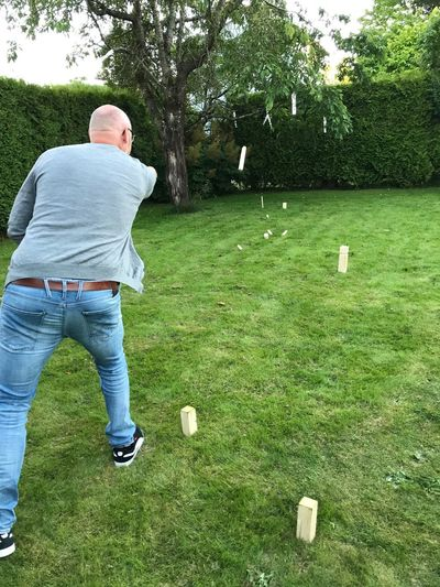 Kubbespill One Man Only One Person Only Men Rear View Tree Day Full Length Men Outdoors Grass Adults Only Standing Adult People Golf Club Nature Playing Kubb Leisure Activity