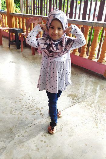 Full length portrait of cute girl standing on floor