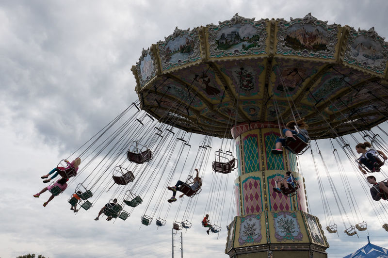 on the swing. Air Built Structure Clouds Fun People Rides State Fair Swing