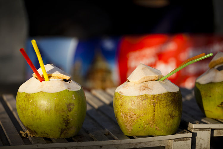 Coconut waters with straws on table