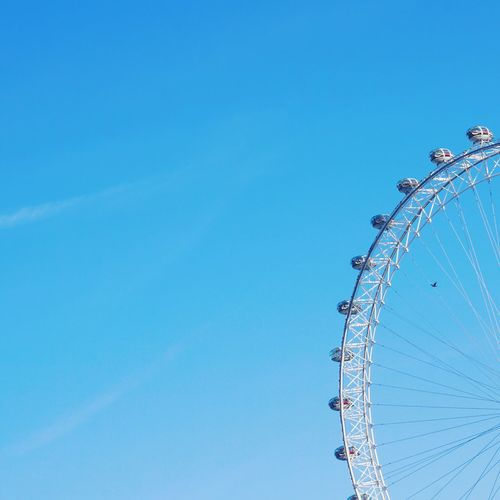 London Eye and blue Sky Minimalism Minimal Arts Culture And Entertainment Amusement Park Blue Amusement Park Ride Copy Space Ferris Wheel Low Angle View Clear Sky 10