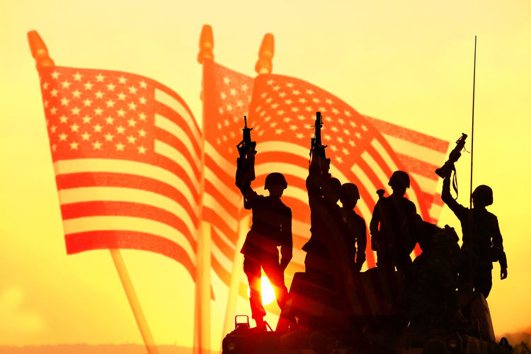 Soldiers silhouettes against with American flag at sunset. The winner concept. Winner Win Sunset Gun War Military Weapon Silhouette Rifle Army Soldier Armed Combat Man Warrior Terrorism Sunrise Violence Enemy Dusk Commando Defend Training Firearm 4th America American Bee Color Day Field Flag Fourth Freedom Glory Grass Green Holiday Honor Independence July Landscape Marker Memory Military Nation National Nobody Park Patriot Patriotic Patriotism Pride Red Remember Small Spring Star States Stripes Summer Symbol Symbolic  United Us USA Veteran Wasp Waving White Wind