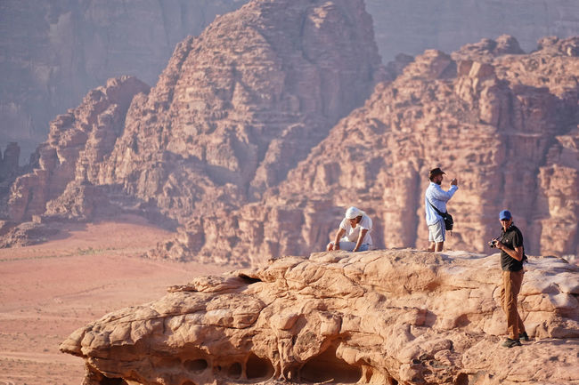 Desert Wadi Rum Activity Adult Adults Only Adventure Cliff Day Desert Full Length Marsions Men Mountain Nature Only Men Outdoors People Rock - Object Rock Face Rock Formation Rogue One Standing Two People Women Working