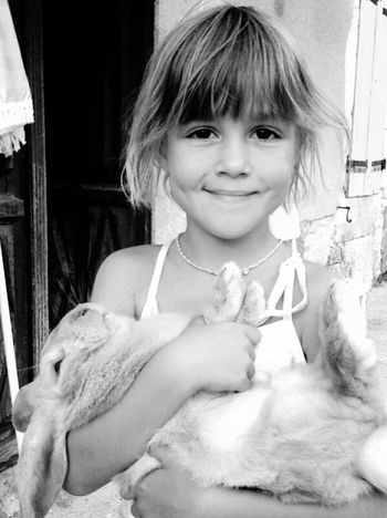 Portrait One Girl Only Vertical One Person Looking At Camera Girls Child Cute Childhood Children Only Sitting Smiling People Outdoors Close-up Day Monochrome Photography Daughter Love Family Rabbit Rabbit ❤️ Rabbit 🐇 Real People Sunlight