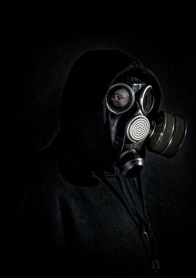 I am the last Close-up Virus Virus Attack Contageous Getty X EyeEm Getty Images Gas Mask War Death Pollution Effects Pollution Jeff Sinnock Hoddie One Person Black Background Accidents And Disasters