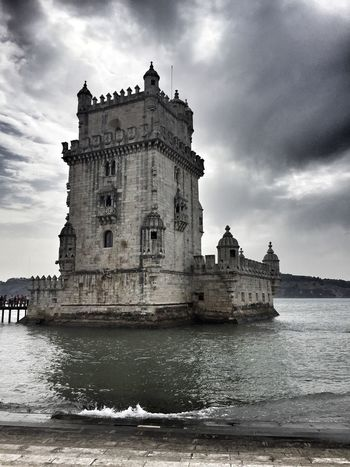 Belém tower Portugal Shanti Tower Ocean Travel EyeEmNewHere Architecture Built Structure Sky Cloud - Sky Building Exterior History An Eye For Travel Day Travel Destinations Tourism Water Low Angle View