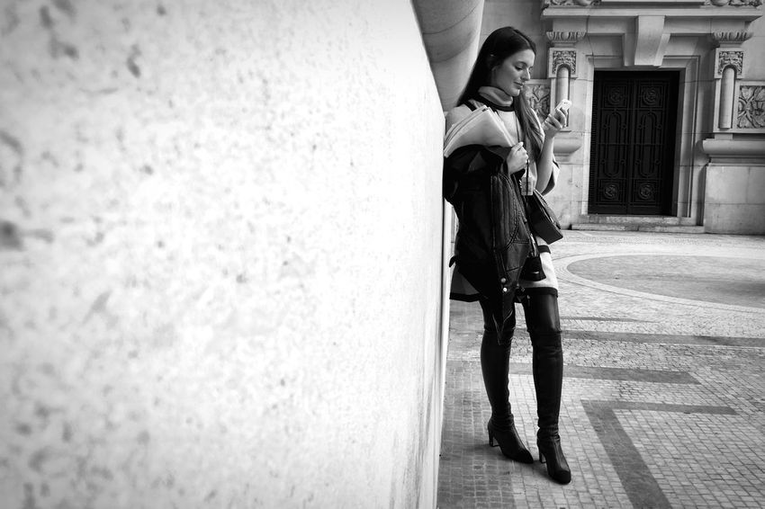 A Fashionista checks her Phone outside the Chanel SS16 Fashion Show at Paris Fashion Week Thigh High Boots shot on IPhone 6s Fashion