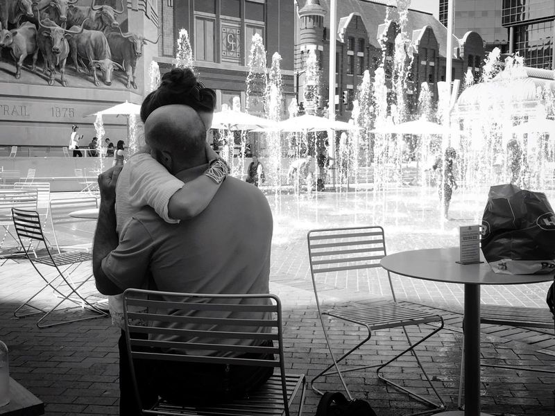 Absolutely LOVE this photo and this couple... This couple is clearly so in love and it makes my heart happy. Architecture Building Exterior City City Life Casual Clothing Togetherness Outdoors Well-dressed Day In Front Of Architectural Column Water Love ♥ Happiness Fort Worth Stockyards Fountains My Favorite Place