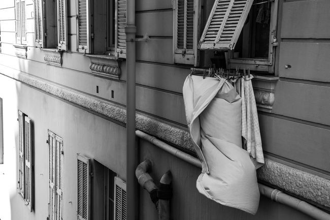 Architecture Balcony Building Building Exterior Built Structure Clothing Day Drying Hanging House Laundry Low Angle View No People Open Outdoors Pipe - Tube Residential District Towel Wall - Building Feature Window