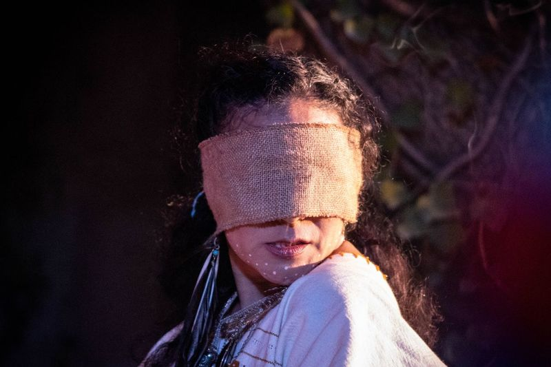 Close-up of woman wearing burlap