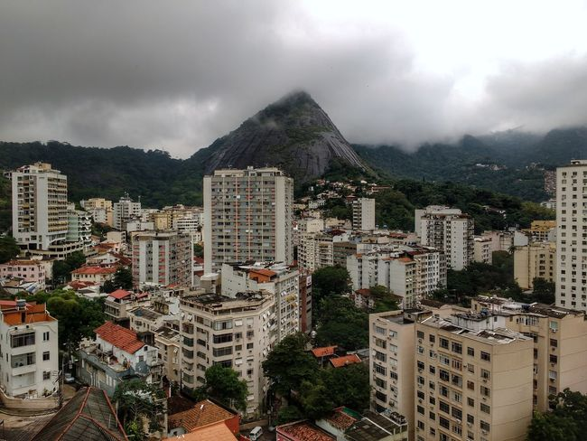 Cityscape with buildings and mountains. Cityscape Skyscraper Building Exterior Mountain City Aerial View Urban Skyline No People Outdoors Day Tree Tropical Capital Cities  Vacations Ecology Mountain Range Nature Meets Urban Living With Nature Hillside Brazilian Forest Cloud - Sky Backgrounds Urban Jungle Storm Cloud