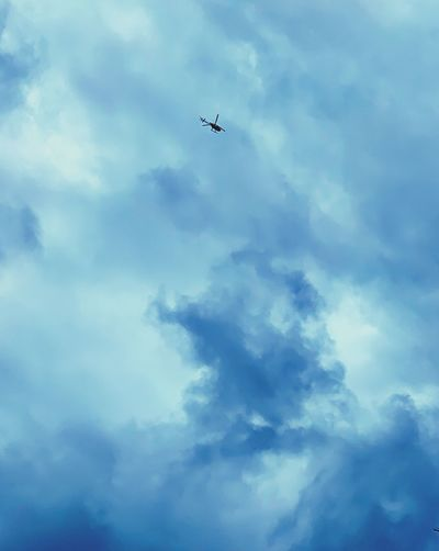 Blue sky is on fire Helicopter Cloud - Sky Sky Low Angle View Flying Airplane Air Vehicle Transportation Mode Of Transportation No People Nature Mid-air Day Outdoors Overcast Blue on the move Beauty In Nature Motion Directly Below