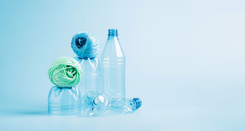 Close-up of glass bottle against blue background