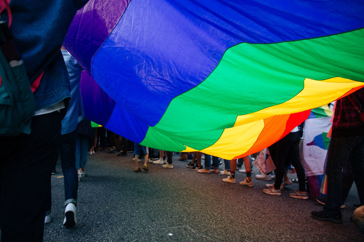 People On With Rainbow Flag During Parade