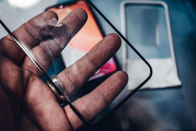 Close-up of hand holding smart phone