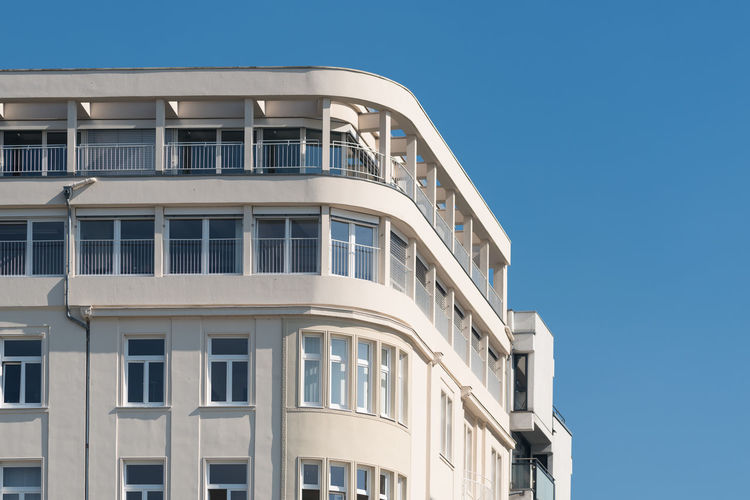 DUESSELDORF, GERMANY - SEPTEMBER 14, 2016: The facade of a modern building at the Rhine promenade contrasts with the blue sky. Architecture Architecture Archival Attraction Balcony Building Exterior Business Finance And Industry Day Düsseldorf Germany Government M Medienhafen New Media Harbor No People Outdoors People Place To Be  Scenics Ship Tourism Urban Urban Geometry Water