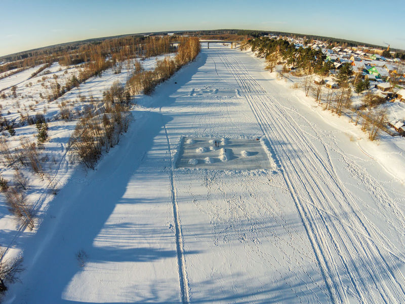 Aerial view of the river Mologa near the village Fabrika. A Bird's Eye View Aerial Aerial View Beauty In Nature Clear Sky Cold Temperature Countryside Day Drone  Dronephotography Ice Ice Rink Landscape Nature Outdoors Rural Scene Scenics Sky Snow Sunlight Tranquility Winter