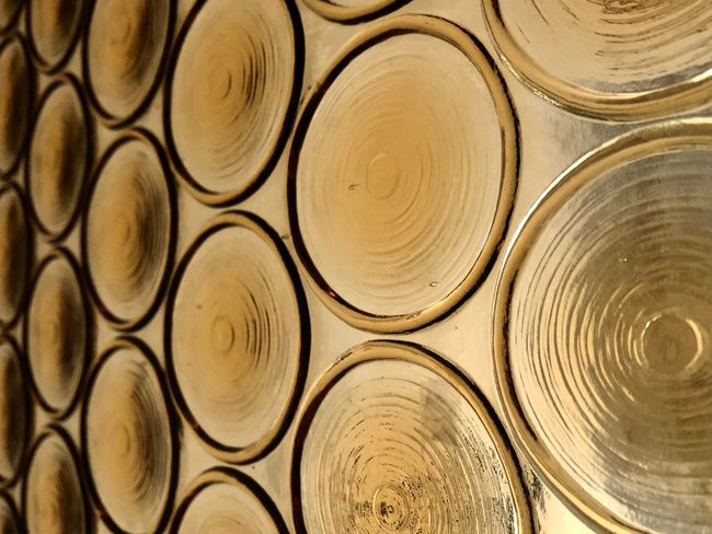 Circles.... Getting Inspired Architecture Abstract EyeEm Selects Full Frame Backgrounds Pattern Close-up Circle No People Shape Geometric Shape Textured  Design Indoors  Repetition Gold Colored