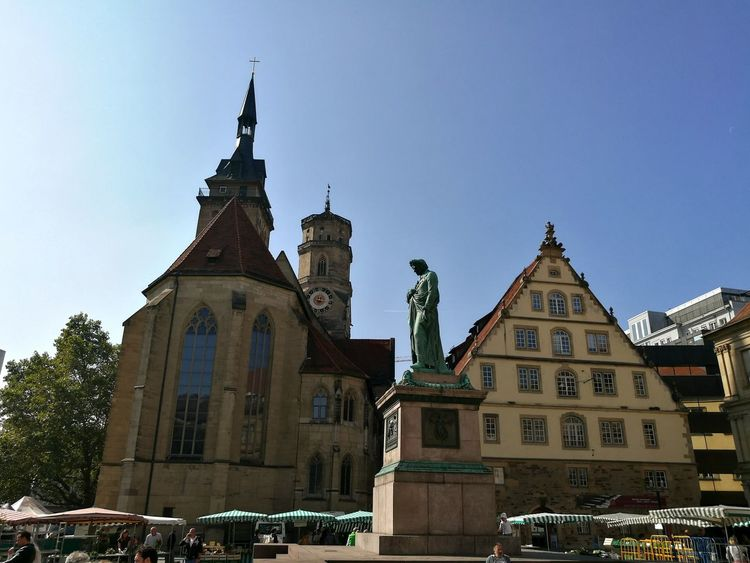 Saturday is market day and the Statue of Friedrich Schiller whatches the Scene. Architecture Statue Sculpture Travel Destinations City Memorial City Life Tourism Old Town Middle-aged Schiller Stuttgartsmartphonephotographer The Past Old Buildings Famous Place National Landmark Stuttgart Street Market Church