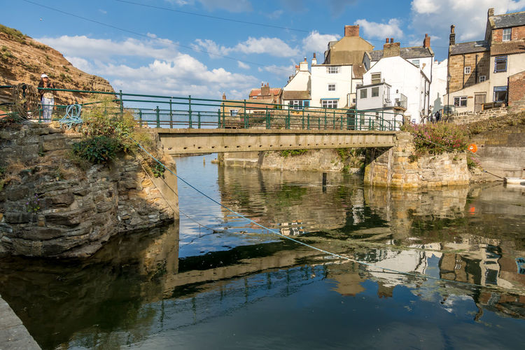 Staithes North Yorkshire Architecture Built Structure Water Building Exterior Reflection Bridge Connection Bridge - Man Made Structure Sky Nature Building Day No People Cloud - Sky River Waterfront Transportation City Residential District Outdoors Arch Bridge
