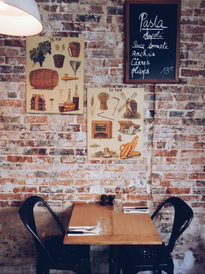 Arrangement Cafe Choice Design Dining Eating Guidance Hanging Home Interior Indoors  Information Menu Paris Restaurant Rustic Sign Single Object Still Life Table Table For Two Text Time Shop Around The Corner Wall Wall - Building Feature