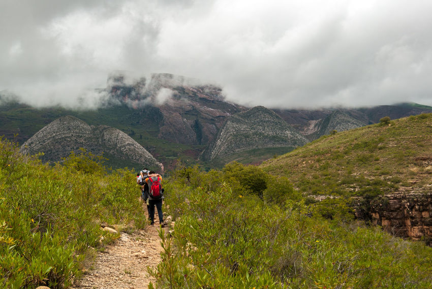 path walking Bolivia Adventure Backpack Beauty In Nature Cloud - Sky Day Exploration Footpath Full Length Healthy Lifestyle Hiking Landscape Leisure Activity Mountain Mountain Range Nature Outdoors People Scenics Sky Standing Torotoro Vacations Walking