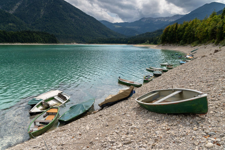 Sylvensteinspeicher Mountain Nautical Vessel Transportation Water Boats Beauty In Nature Lake Alps Bavarian Alps Rowboat Tranquility Moored Outdoors Scenics - Nature Tranquil Scene Mountain Range Mode Of Transportation Nature Day No People Cloud - Sky Sky Non-urban Scene Beach