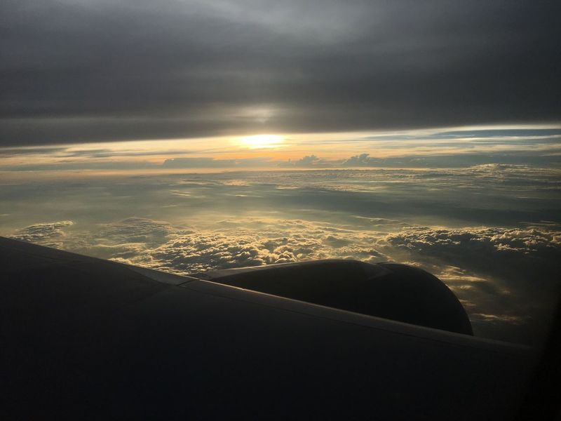 Aerial View Nature Cloud - Sky Beauty In Nature Scenics Cloudscape Mobility In Mega Cities Landscape Outdoors Airplane Wing Travel Mode Of Transport Transportation No People Tranquility Sunset Airplane Sky Tranquil Scene Air Vehicle Journey