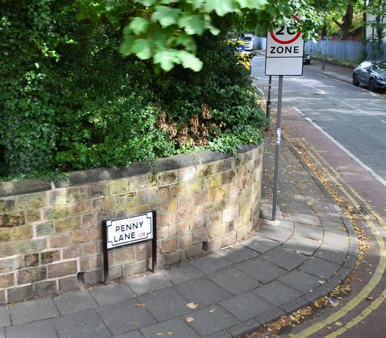 Penny Lane street sign, made famous by The Beatles in the 1960s. Liverpool Signage Communication Day Growth Nature No People Outdoors Penny Lane  Plant Road Sign Street Sign Streetphotography Text The Beatles Tree Western Script