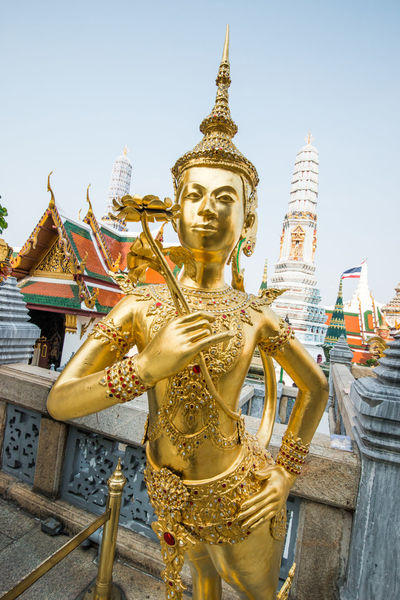 Statue in Wat Phra Kaew , Bangkok ,Thailand Architecture Buddha Building Exterior Built Structure Clear Sky Culture Day Gilded Gold Gold Colored Golden Golden Color Human Representation Idol Low Angle View Outdoors Place Of Worship Religion Sculpture Spire  Spirituality Statue Temple Temple - Building
