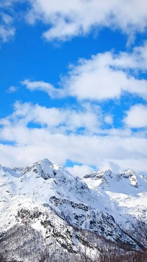 White clouds and blue sky over snow covered mountain top Cloud - Sky No People Outdoors Sky Nature Wintertime Mountain Peak Snowcapped Mountain Winter Beauty In Nature Snow ❄ Travel Destinations Idyllic Europe Triglav Slovenia Triglav National Park Scenics Mountain Cold Temperature Nature Landscape Abstract Morning Snow
