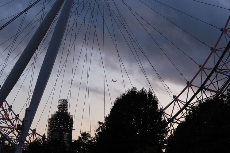 Low angle view of silhouette bridge against sky at sunset