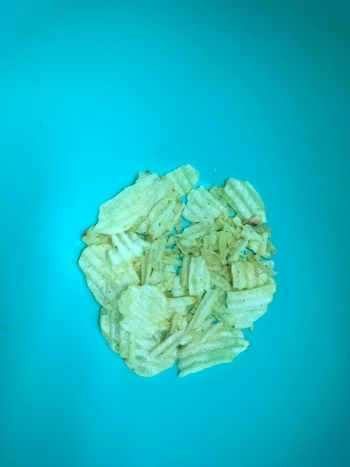 Left over chips at bottom of a salad bowl. Party Ends Unhealthy Eating Unhealthy Food Food Leftovers Salty Food Junk Food Crisps Chips Blue Background Colored Background No People Blue Close-up Food EyeEm Ready   Food Stories