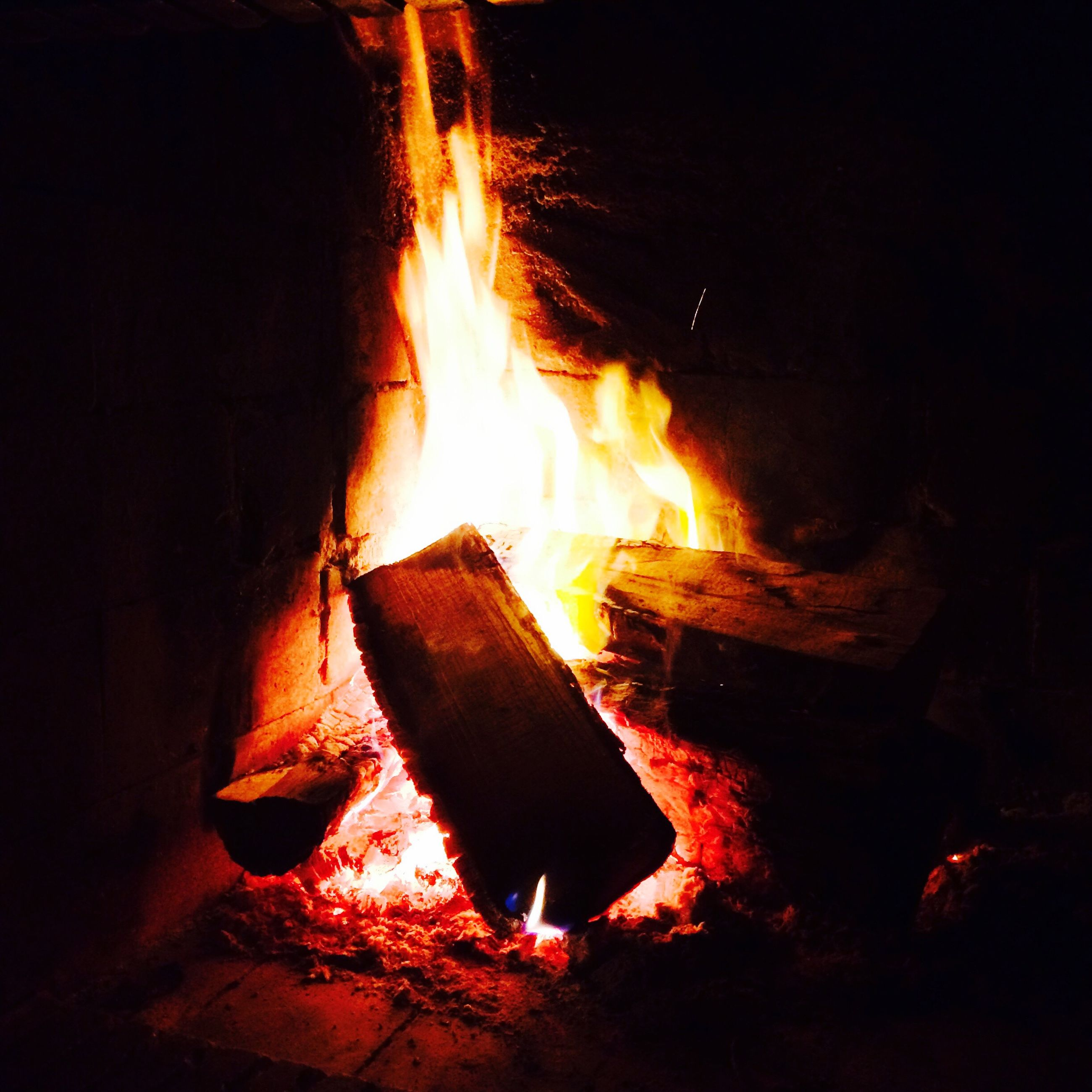 burning, flame, fire - natural phenomenon, heat - temperature, night, glowing, bonfire, firewood, fire, heat, campfire, dark, orange color, close-up, illuminated, motion, wood - material, light - natural phenomenon, fireplace, lit