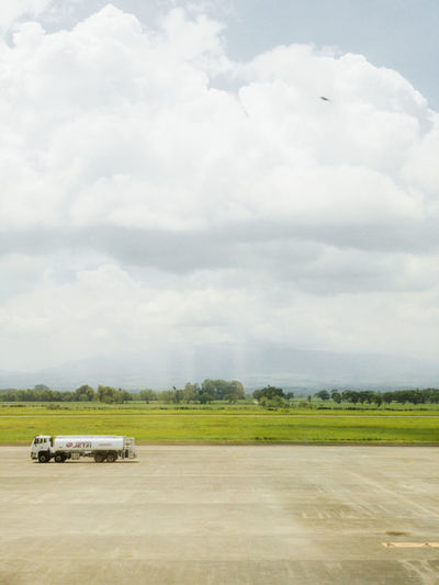 Scenic view of airport runway against sky