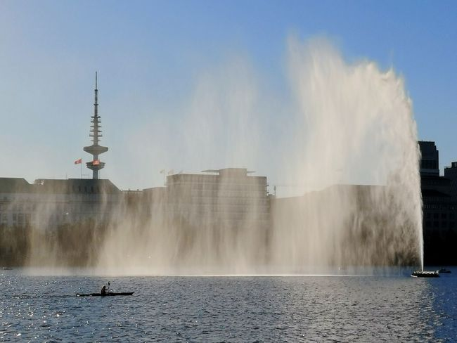 Alsterfontaene Alster fountain backlit by sun with Heinrich Hertz television tower Alster Hamburg Alster Fountain Alsterfontäne Alster Hamburg Alster Lake Water City Waterfall Motion Spraying Sky Architecture Long Exposure Television Tower Tower Flood Splashing Tall - High Fountain Entertainment Extreme Weather High-speed Photography Flowing Water Drinking Fountain