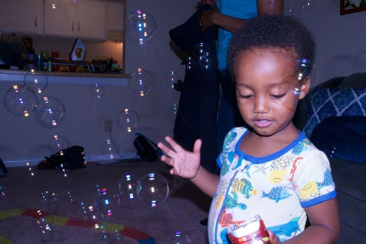 Zaheer playing with bubbles in North Carolina. 2017 ArtWork Baby Bubbles Fun New Nikon Bubble Wand Child Childhood Flash Indoors  One Person People Photography Real People Toddler  Vacation The Still Life Photographer - 2018 EyeEm Awards