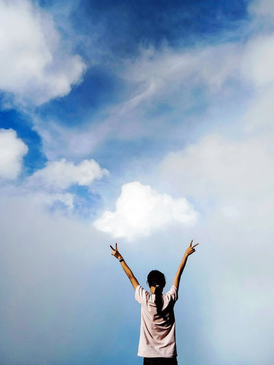 Human Arm Sky Cloud - Sky Real People One Person Arms Raised Rear View Leisure Activity Lifestyles Limb Day Standing Nature Waist Up Arms Outstretched Beauty In Nature Outdoors Freedom Men Excitement Human Limb
