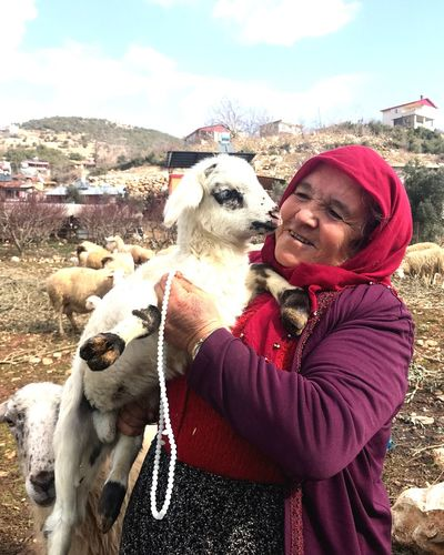 lamb and woman One Animal Domestic Animals Pets Domestic Mammal Real People International Women's Day 2019 Canine Vertebrate Dog One Person Day Lifestyles Sky Leisure Activity Nature Young Adult Winter Warm Clothing Pet Owner Outdoors
