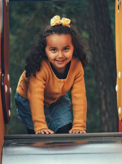 Portrait of happy girl on slide