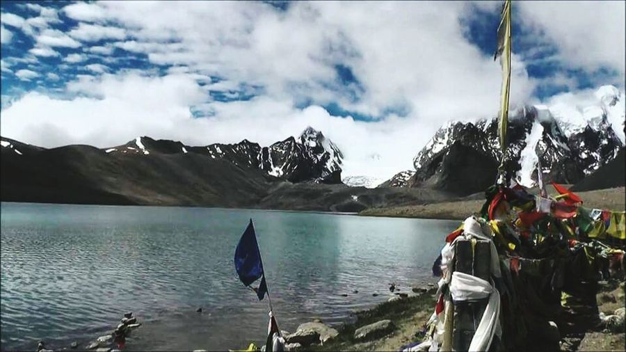 Its shoing that how Beautyful our EARTH is.... Check This Out its tuch the inner Heart.... With full ofBlue Sky.... Beyound Lake... Around Snow Mountain.... An bloing Clouds..... Beauty of nature... Enjoy Ittt...