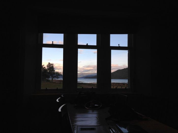 No! Leave the lights off... it isn't properly dark yet. Loch  Scotland EyeEm Selects Window Sky Indoors  Architecture Glass - Material No People Transparent Water Nature Day Built Structure Silhouette Domestic Room Cloud - Sky Dark Looking Through Window