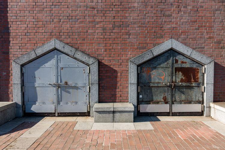 Open door of brick wall