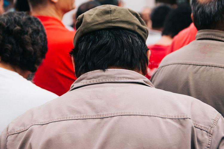 Rear view of man walking in crowd