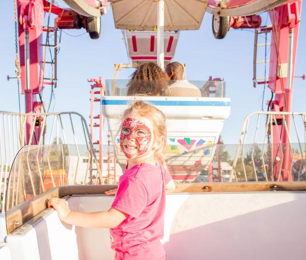 Portrait of smiling girl ride at amusement park