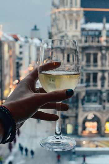 Human Hand Hand Food And Drink Drink Refreshment Holding Alcohol Glass One Person Human Body Part Wine Real People Focus On Foreground Built Structure Architecture Building Exterior Wineglass Glass - Material Lifestyles Leisure Activity Finger Red Wine Drinking