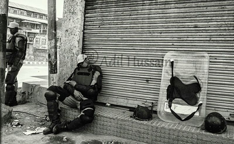 "Indian paramilitary cop taking nap during a curfew in Old Srinagar, the summer capital of Indian-administered Kashmir. Authorities on Saturday clamped curfew like restrictions in parts of Old Srinagar to foil proposed rally of pro-freedom groups towards Martyrs Graveyard ""Eid-Gah"" on the martyrdom anniversary of two prominent pro-freedom figures Mirwaiz Molvi Farooq and Ab. Gani Lone on May 21, 2016. While as a complete shutdown was observed across Kashmir valley on the martyrdom anniversary of slain leaders. Taking Photos Documentary The Photojournalist - 2016 EyeEm Awards Curfew Sleepingonstreet Sleepingonthejob Downtown Storyteller Popular Photooftheday Photojournalism Srinagar  Streetphoto EyeEm Best Shots - The Streets EyeEm Masterclass ASIA Check This Out News Press Photography"
