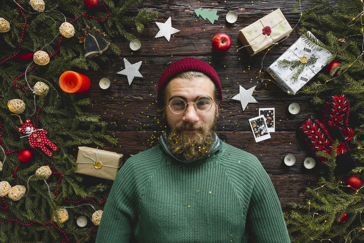 Christmas portrait of a man looks like a Santa Christmas Celebration Decoration Christmas Decoration One Person Holiday christmas tree Portrait Christmas Ornament Beard Looking At Camera Facial Hair Indoors  Real People Front View