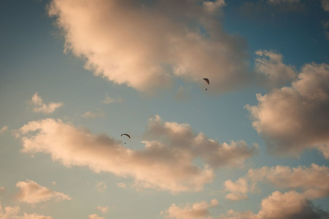 chasing sunset Sunset Go Higher Paragliding Parachute Leisure Activity Flying Cloud - Sky Sky Mid-air Low Angle View Outdoors Above