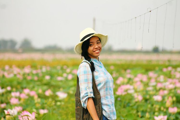 Close-Up Of A Smiling Young Woman In Field